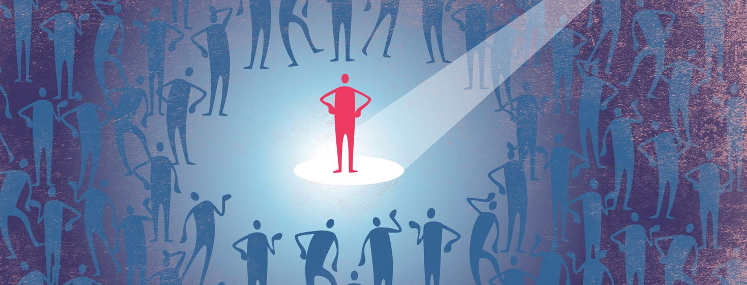 A red person stands in a spotlight and blue people stand far away.