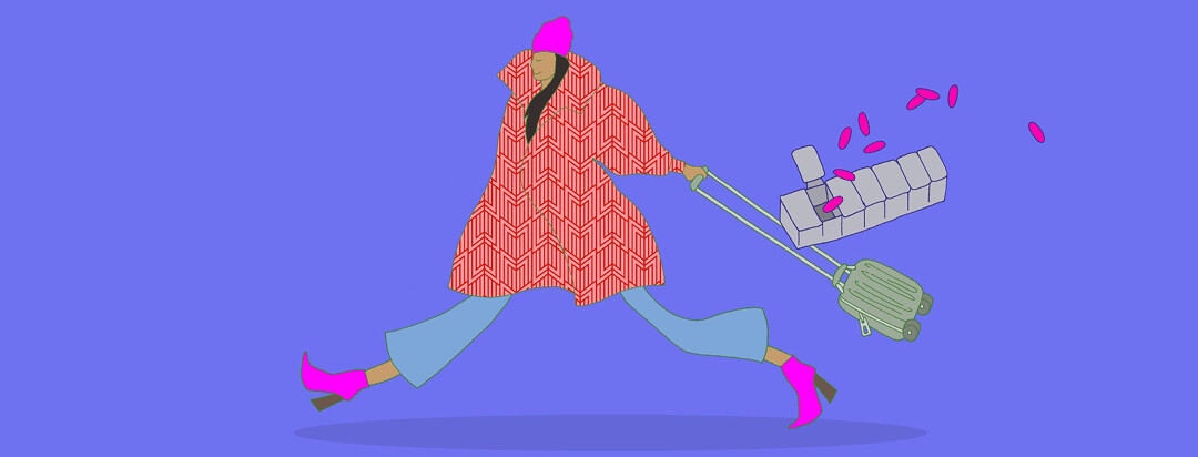 a woman wearing a hat and a large coat pulling a roller bag and a box of HIV medication