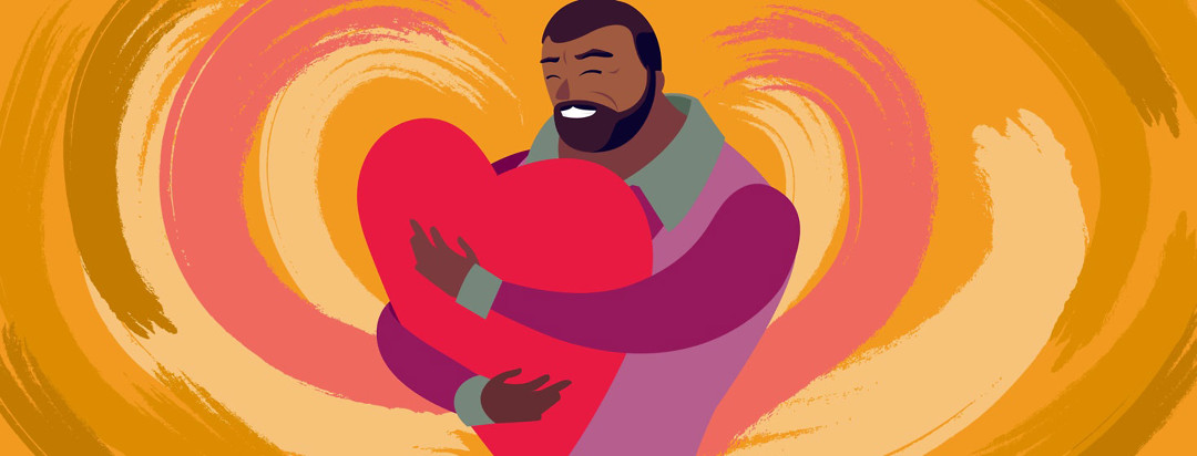 a large older man holds a giant heart and hugs it