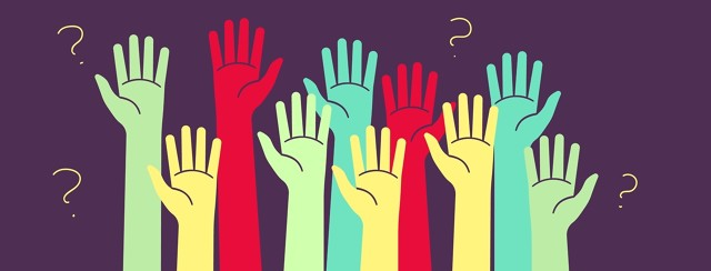 Multicolored hands raised to ask questions.