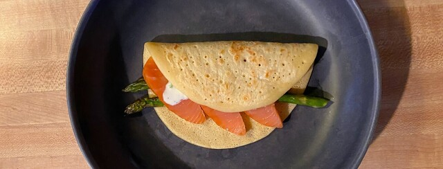 Smoked Salmon and Asparagus Crepe on a charcoal colored plate.