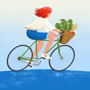 A young woman rides her bicycle with basket full of food
