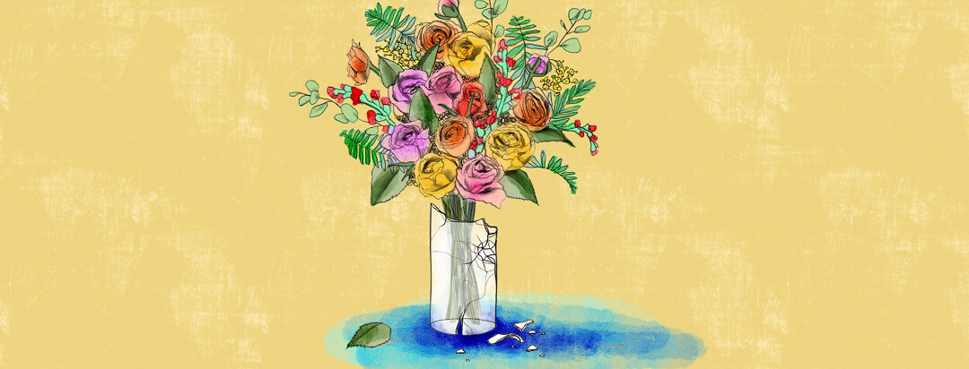 a beautiful bouquet of flowers is placed within a broken shattered glass vase, where all the water is spilling out on the table